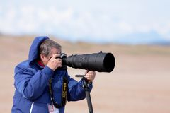 Photographer. In action on the coast of the Cantabrian Sea Royalty Free Stock Photo