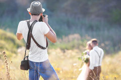 Photographer in action Royalty Free Stock Photography