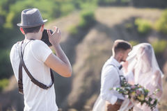 Photographer in action Royalty Free Stock Photos
