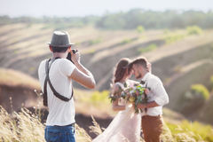Photographer in action Royalty Free Stock Images