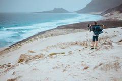 Photographer admitting unique others worldly landscape of sand dunes volcanic cliffs on the Atlantic coast. Baia Das. Gatas, near Calhau, Sao Vicente Island Stock Photography