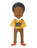 Photographer. An african-american photographer holding a camera vector flat design illustration  on white background. Vertical layout Royalty Free Stock Images