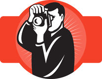 Photographer aiming slr camera front Stock Image