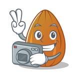 Photographer almond nut character cartoon Royalty Free Stock Photo