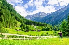 Photographer and alpine landscape in Alps, Austria Stock Photo