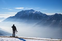 Photographer in the alps Royalty Free Stock Photo