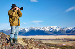 Photographer in Altai mountains Royalty Free Stock Image