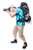Photographer in ambush with a big backpack on a white Stock Photography