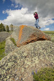 Photographer and ancient orange lichens growing on rocks in Centennial Valley near Lakeview, MT Stock Images