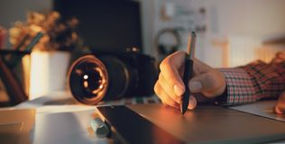 Free Photographer And Designer Working At Office Royalty Free Stock Images - 124239149