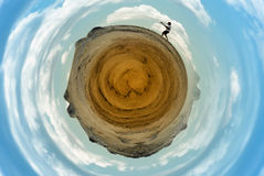 Photographer on arid round planet Royalty Free Stock Photo