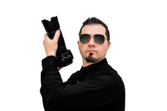 Photographer as a Special Agent on white backdrop. A Photographer with a DSLR camera acting as a Special Agent on awhite backdrop stock photography