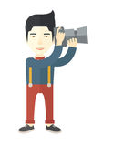 Photographer. An asian photographer holding a camera vector flat design illustration  on white background. Vertical layout Stock Photo