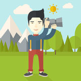 Photographer. An asian photographer taking photo in mountains vector flat design illustration. Square layout Royalty Free Stock Photography