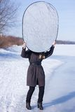 Photographer assistant holding reflector Stock Image