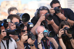 Photographer attends the `120 Beats Per Minute 120 Battements P Royalty Free Stock Photo