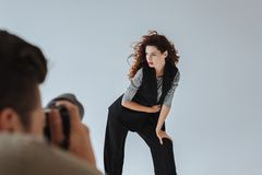 Photographer and attractive model Royalty Free Stock Image