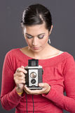 Photographer Attractive Woman Holding Camera. Pretty Woman practicing photography waist finder Royalty Free Stock Photo