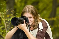 Photographer in autumn forest stock photo