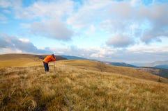 Photographer and autumn mountains Stock Photos