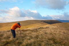 Photographer and autumn mountains Stock Image