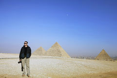 Photographer on the background of the desert and the pyramids of Egypt. Egypt Stock Image