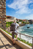 Photographer with backpack shooting in old town Sozopol near sea stock photo