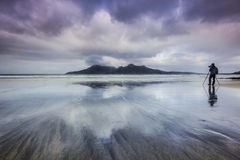 Photographer on the Bay of Laig - Isle of Eigg, Scotland. Stock Image