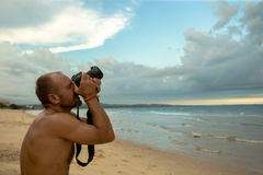 Photographer on the beach royalty free stock photos
