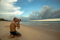 Photographer on the beach Stock Image