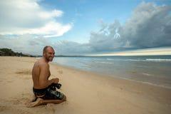 Photographer on the beach royalty free stock photo