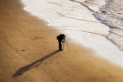 Photographer on beach Stock Photography