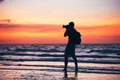 Photographer on the beach Royalty Free Stock Images