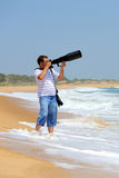 Photographer on the beach Royalty Free Stock Image