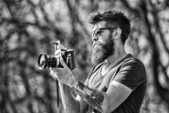 Photographer with beard and mustache amateur photographer nature background. Man with long beard busy with shooting. Photos. Photographer concept. Man bearded stock images