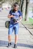 Photographer with beard and mustache. Tourist shooting photos. Content creator. Man bearded hipster photographer. Old. But still good. Photographer hold vintage royalty free stock images