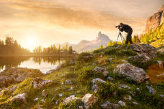 A photographer in the beautiful lake Federa Stock Images