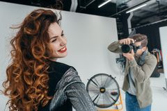 Photographer and beautiful model Royalty Free Stock Images