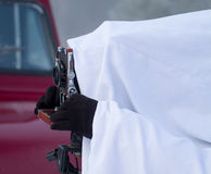 Photographer behind the hood Stock Photography