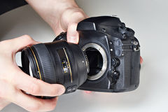 Photographer with big lens and digital SLR camera Stock Image