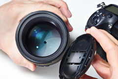 Photographer with big lens and SLR camera Royalty Free Stock Images