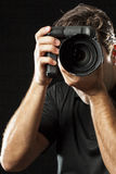 Photographer on black. Stock Photo