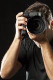 Photographer on black. Stock Photo