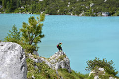 Photographer and blue lake stock photography