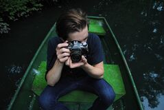 Photographer in Boat Holding Canon AE-1 Stock Images