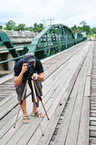 Photographer on Bridge over Pai River at Pai at Mae Hong Son Thailand Stock Image