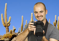 Photographer and cactus background Stock Images