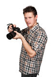 Photographer with a camera. In the studio Royalty Free Stock Photos