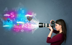 Photographer with camera and abstract imaginary. Cute photographer girl with camera and abstract imaginary Stock Photo