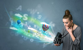 Photographer with camera and abstract imaginary Stock Image